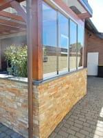 Glasschiebewand für Holz Terrassendach vierteilig